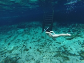 Swimming at Zacil Ha Cenote in Tulum Mexico